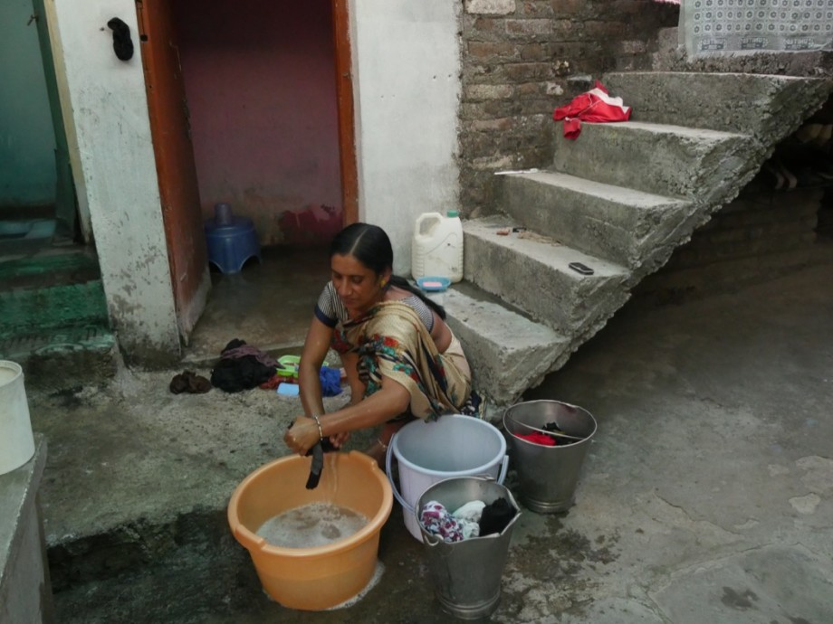 Lady doing the family wash by hand